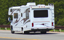 Recreational RV vehicle with reflective markings.