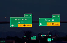 Highway signs at night.